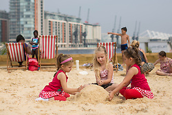 © licensed to London News Pictures. London, UK 23/08/2013. Children enjoying the hot weather and playing at Royal Victoria Beach in east London on Friday, 23 August, 2013. Photo credit: Tolga Akmen/LNP