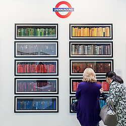 "© Licensed to London News Pictures. 19/05/2016. London, UK. Visitors view Phil Shaw's ""Londonensi Subterraneis"".  Art16 opens at Olympia, in west London.  Now in its fourth edition, the fair brings together over 100 galleries from more than 30 countries showcasing a diverse cross-section of work by contemporary artists from around the world for buyers and art enthusiasts to visit. Photo credit : Stephen Chung/LNP"