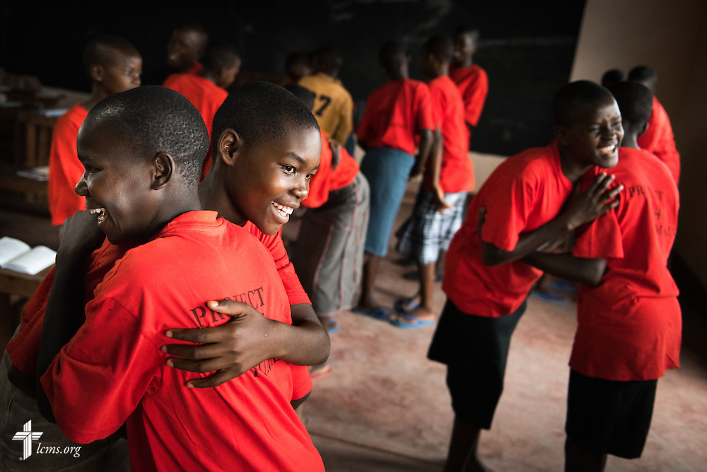 Young ladies hug each other following catechism class at the Tumaini ELCK (Evangelical Lutheran Church in Kenya) Project 24 boarding facility on Sunday, Oct. 18, 2015, in Kisumu, Kenya. LCMS Communications/Erik M. Lunsford