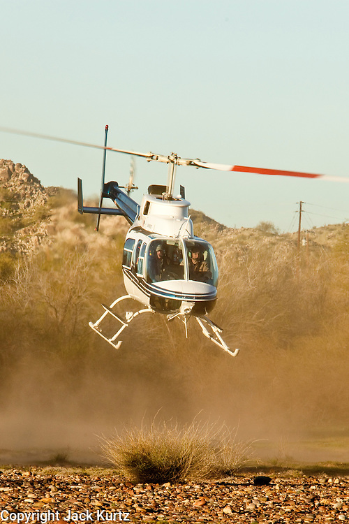 16 MARCH 2010 -- BUCKEYE, AZ:The helicopter takes off to go fetch Colorado in the Gila River bed after being rescued near Buckeye Tuesday morning. Colorado has spent the last several days marooned on a sandbar in the middle of the river after he and his owners were nearly swept downstream during a trail ride.   PHOTO BY JACK KURTZ