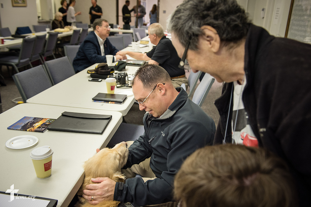 Jonah Domenichelli plays with Tara, a comfort dog from the Lutheran Church Charities Kare-9 program during a break at the 2015 Operation Barnabas Conference on Tuesday, Feb. 10, 2015, at Mount Calvary Lutheran Church in San Antonio, Texas.  LCMS Communications/Erik M. Lunsford