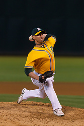 June 29, 2011; Oakland, CA, USA; Oakland Athletics relief pitcher Craig Breslow (56) pitches against the Florida Marlins during the seventh inning at the O.co Coliseum.  Florida defeated Oakland 3-0.
