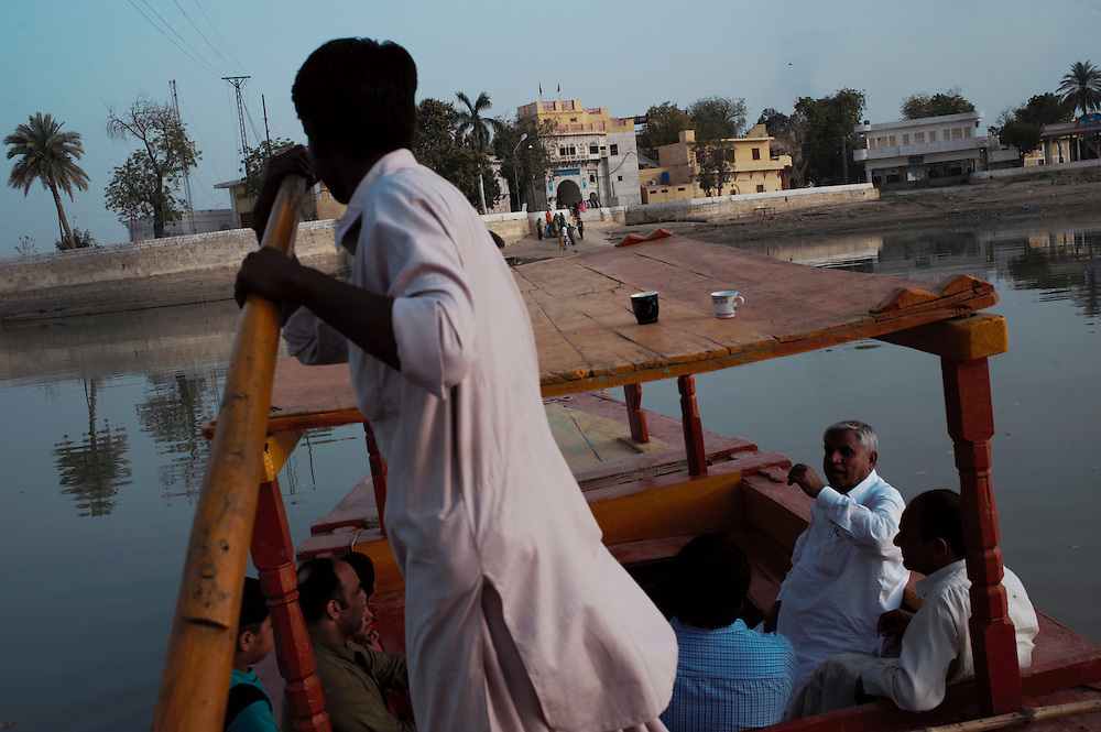 A boat operator ferries passengers across the water to Sadhu Bela, a Hindu temple on the Indus River, Sukkur, Sindh province, Pakistan on March 23, 2012. A rise in in reports of forced conversion of Hindu girls to Islam in provinces in Pakistan has gained prominence within the political, media, religious and social domains with the case of a 21 year old woman Rinkle Kumari. On February 24, 2012 her family reported to police of Ghotki district, Sindh province that she had been abducted by armed men from the family home in the village of Mirpur Mathelo. it is then alleged by the family and broadrer hindu community that she was forced to convert to Islam and marry Syed Naveed Shah, a neighbour of the girl within their village. Complications with court hearings for the case, perceptions by the Muslim community that the police sided with the Muslim community when dealing with issue and the politicisation of the case by a Pakistan Peoples Party Member for National Assembly Mian Abdul Haq alias Mian Mitho has led to a hearing being called in the Supreme Court, Islamabad, Pakistan on March 26, 2012. The hearing will hopefully ascertain whether the girl was abducted or in fact left with Syed Naveed Shah of her own free will.