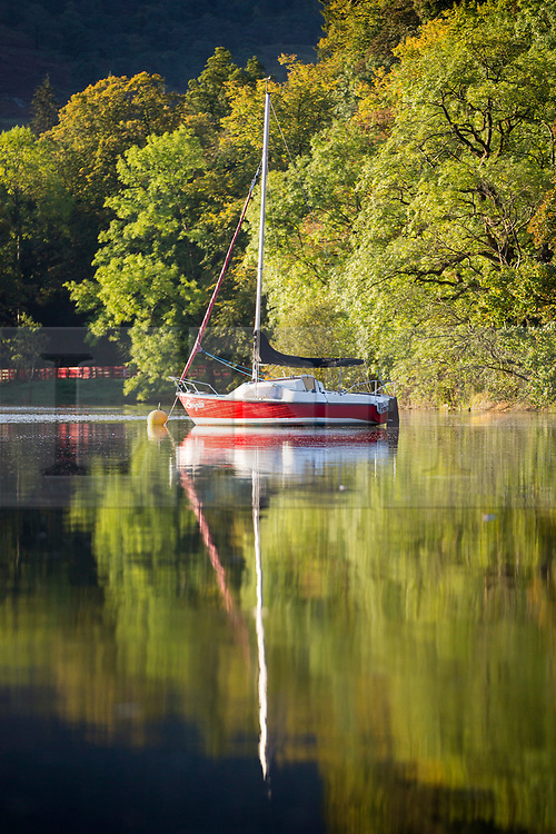 © Licensed to London News Pictures. 28/09/2017. Glenridding UK. Boats reflect in the calm water of Ullswater Lake in the village of Glenridding this morning. Photo credit: Andrew McCaren/LNP