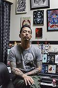 Yokohama, Kanagawa prefecture, Japan, October 4 2016 - Portrait of tattoo master Aki Bontan at his studio, Diablo Art Aki Studio.