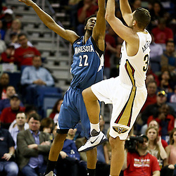 Feb 27, 2016; New Orleans, LA, USA; New Orleans Pelicans forward Ryan Anderson (33) shoots over Minnesota Timberwolves guard Andrew Wiggins (22) during the first half of a game at  the Smoothie King Center. Mandatory Credit: Derick E. Hingle-USA TODAY Sports