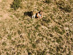 Aerial view of Valentin Gruener and Sirga the lion, (Panthera leo), Grasslands Ranch, Kalahari Desert, Botswana Africa