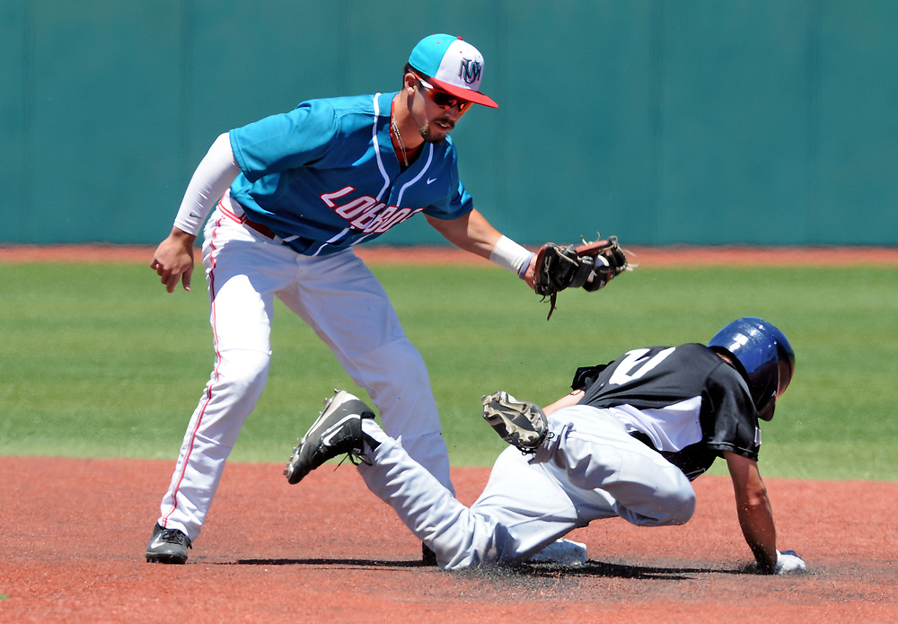 jt052017c/ sports/jim thompson/UNM's shortstop #3 Hayden Schilling makes the tag on Nevada's #10 Chase Grant  as he tried to steal second in their game Saturday.  Saturday May. 20, 2017. (Jim Thompson/Albuquerque Journal)