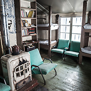 The main living area of Wordie House, with bunks to the right. Originally known as Base F and later renamed after James Wordie, chief scientist on Ernest Shackleton's major Antarctic expedition, Wordie House dates to the mid-1940s. It was one of a handful of bases built by the British as part of a secret World War II mission codenamed Operation Tabarin. The house is preserved intact and stands near Vernadsky Research Base in the Argentine Islands in Antarctica.