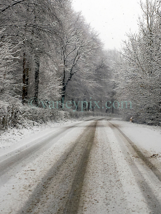 09 February 2018. Aix en Issart, Pas de Calais, Hauts de France.<br /> The snow arrived early in the morning making for some wintry scenes and treacherous driving in Hauts de France.<br /> Photo&copy;; Charlie Varley/varleypix.com