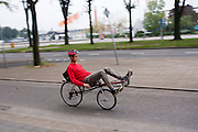 Een ligfietser rijdt bij de Jaarbeurs in Utrecht.<br /> <br /> A man on a recumbent bike is riding near the Jaarbeurs in Utrecht.