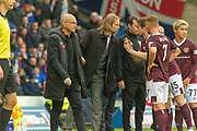 Hearts Interim Manager Austin MacPhee gets a brief chat with his players during the Betfred Scottish League Cup semi-final match between Rangers and Heart of Midlothian at Hampden Park, Glasgow, United Kingdom on 3 November 2019.