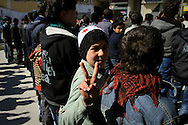 Anti government demonstrators march for regime change and peace in the town of Al Janoudiyah, Syria.