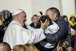 November 12, 2016 - Vatican City, Vatican - Pope Francis greets a baby as he leaves at the end of an extraordinary Jubilee Audience as part of ongoing celebrations of the Holy Year of Mercy in St. Peter's Square in Vatican City, Vatican on November 12, 2016. Pope Francis presided over the last special audience for the Jubilee of Mercy this morning, during which he called on Christians to witness to Gods mercy by being inclusive. (Credit Image: © Giuseppe Ciccia/NurPhoto via ZUMA Press)