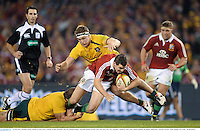 29 June 2013; Jonathan Sexton, British & Irish Lions, is tackled by Ben Alexander, left, and Michael Hooper, Australia. British & Irish Lions Tour 2013, 2nd Test, Australia v British & Irish Lions. Ethiad Stadium, Docklands, Melbourne, Australia. Picture credit: Stephen McCarthy / SPORTSFILE