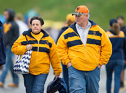 Nov 28, 2015; Morgantown, WV, USA; West Virginia Mountaineers fans walk into the stadium prior to their game against the Iowa State Cyclones at Milan Puskar Stadium. Mandatory Credit: Ben Queen-USA TODAY Sports