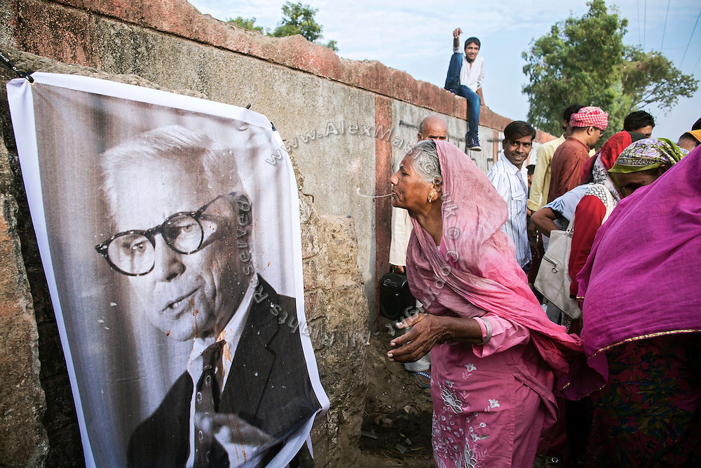 On September 29, 2014, the day of former Union Carbide Warren Anderson's death in Vero Beach, Florida, at the age of 92 and still absconding from India courts wanting him in relation to the '1984 Gas Disaster', angry Bhopalis are demonstrating in front of the abandoned Union Carbide (now DOW Chemical) industrial complex, in Bhopal, Madhya Pradesh, central India, by spitting on an image of the deceased, reputed the man mostly responsible for the catastrophe that changed Bhopal forever.