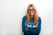 Portrait of happy woman wearing eyeglasses against white background