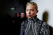 LONDON, ENGLAND - JANUARY 08: Models backstage ahead of the KTZ  during London Fashion Week Men's January 2017 collections at BFC Show Space on January 8, 2017 in London, England. (Photo by Ki Price/Getty Images)