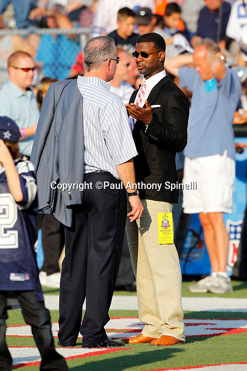 Dallas Cowboys Executive Vice President-COO Stephen Jones and former San Francisco 49ers player Merton Hanks chat before the NFL Pro Football Hall of Fame preseason football game between the Dallas Cowboys and the Cincinnati Bengals on Sunday, August 8, 2010 in Canton, Ohio. The Cowboys won the game 16-7. (©Paul Anthony Spinelli)
