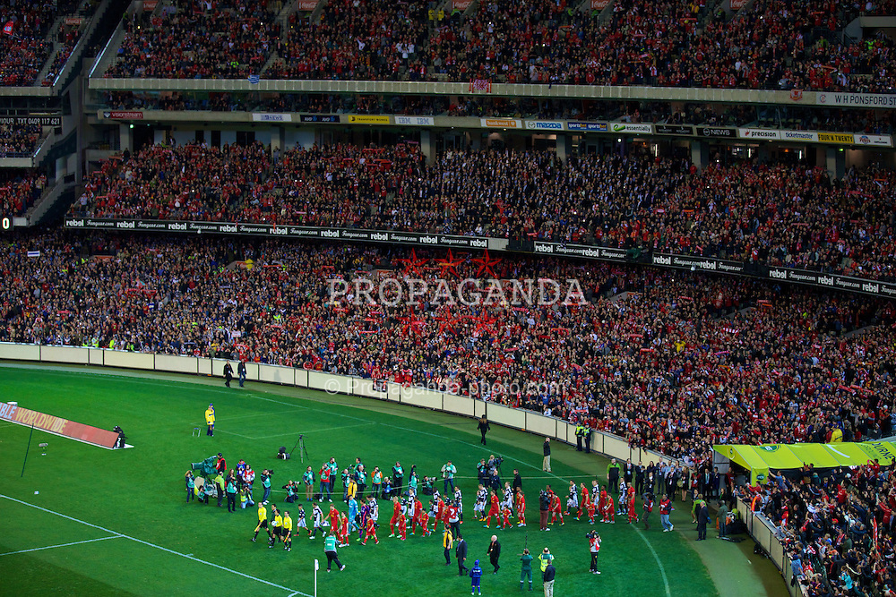MELBOURNE, AUSTRALIA - Wednesday, July 24, 2013: Liverpool players walk out to take on Melbourne Victory during a preseason friendly match at the Melbourne Cricket Ground. (Pic by David Rawcliffe/Propaganda)