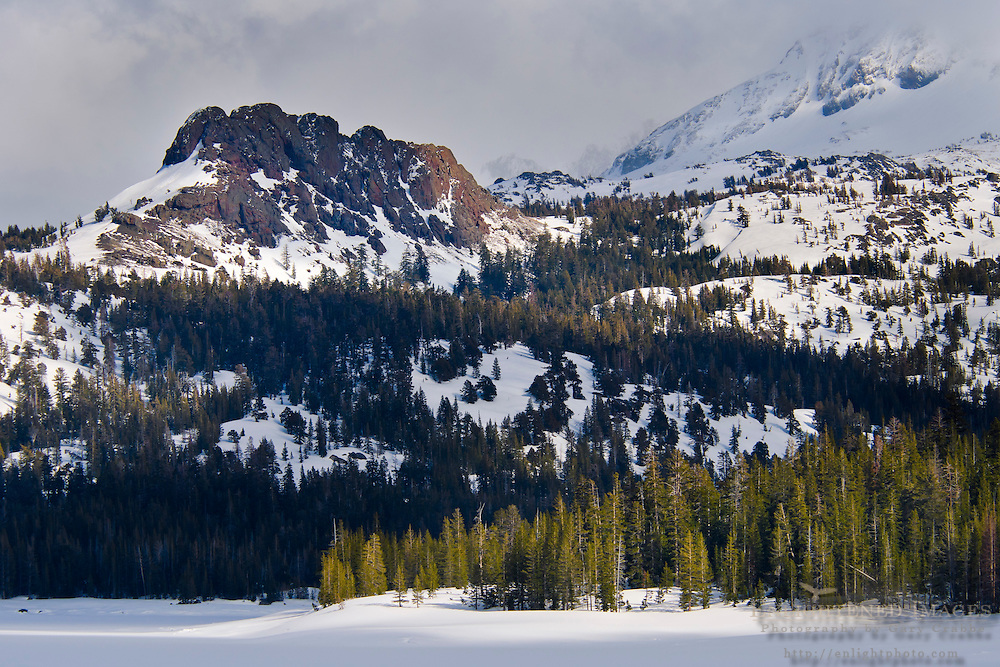 Mountains of the Sierra Nevada in winter above a frozen Caples Lake, near Carson Pass, Alpine County, California