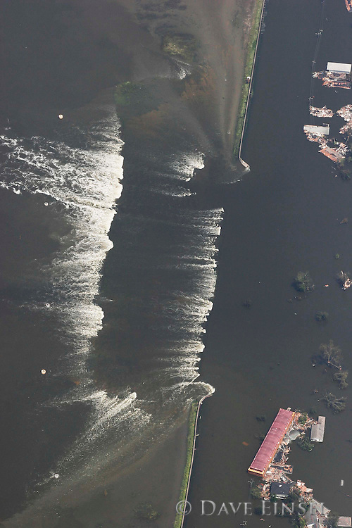IN FLIGHT- AUGUST 30: Water spills over a levee east of downtown New Orleans, Tuesday, August 30, 2005. Over 100 people are feared dead and estimates put the property loss at nearly $30 billion as Hurricane Katrina could become the costliest storm in US history.<br />