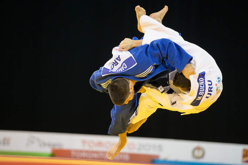 Hector Campos (L) of Argentina throws  Manuel Bueno of Uruguay to win their bronze medal contest in the mens judo -100kg  class at the 2015 Pan American Games in Toronto, Canada, July 14,  2015.  AFP PHOTO/GEOFF ROBINS