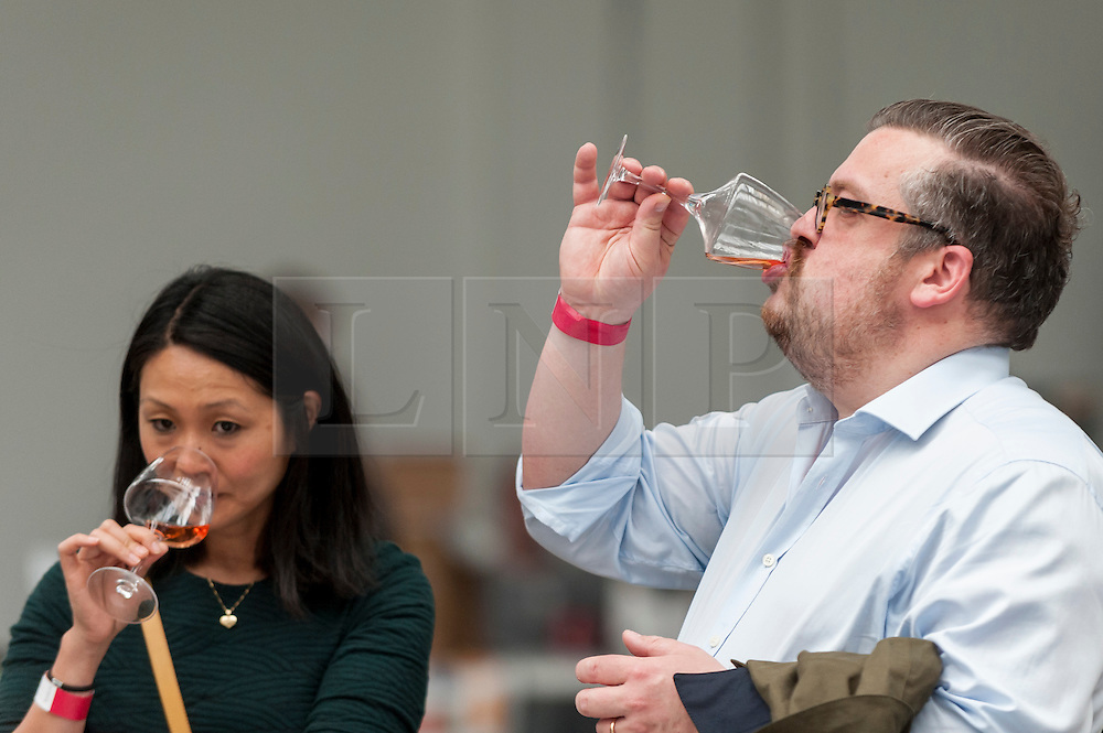 © Licensed to London News Pictures. 16/05/2016. London, UK. Visitors sample wine. Buyers and wine lovers visit the Raw Wine Fair at the Old Truman Brewery near Brick Lane.  The fair brings over 180 artisan growers and wine makers from around the world who specialise in producing organic, biodynamic and naturally made wines with minimal additives. Photo credit : Stephen Chung/LNP