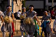 Dancers walking to the next location in the Tenjin Festival (Tenjin Matsuri) in Osaka.