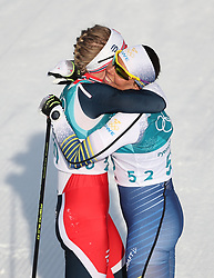 PYEONGCHANG, Feb. 15, 2018  Ragnhild Haga (L) from Norway hugs second-placed Charlotte Kalla from Sweden after finishing women's 10KM free event of country skiing at Pyeongchang 2018 Winter Olympic Games at Alpensia Cross-Country Centre, PyeongChang, South Korea, Feb. 15, 2018. Ragnhild Haga claimed champion in a time of 25:00.5. (Credit Image: © Bai Xuefei/Xinhua via ZUMA Wire)