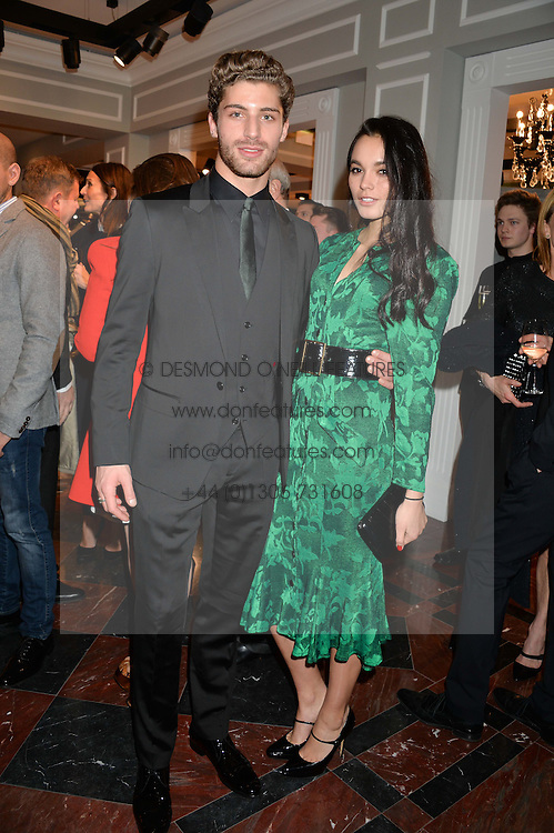 THOM MORRELL and SOLANGE SMITH at the Dolce & Gabbana London Collections: Mens Event 2014 held at Dolce & Gabbana, 53-55 New Bond Street, London on 5th January 2014.