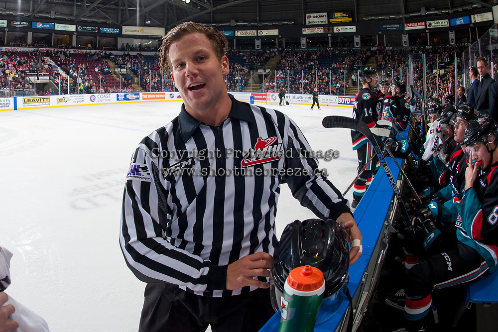KELOWNA, CANADA - SEPTEMBER 22: Linesman Dustin Minty stands at the boards during a time out between the Kelowna Rockets and the Kamloops Blazers on September 22, 2017 at Prospera Place in Kelowna, British Columbia, Canada.  (Photo by Marissa Baecker/Shoot the Breeze)  *** Local Caption ***