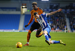 Jamie Murphy of Brighton and Hove Albion is challenged by Dominic Iorfa of Wolverhampton Wanderers - Mandatory byline: Paul Terry/JMP - 07966 386802 - 01/01/2016 - FOOTBALL - Falmer Stadium - Brighton, England - Brighton v Wolves - Sky Bet Championship