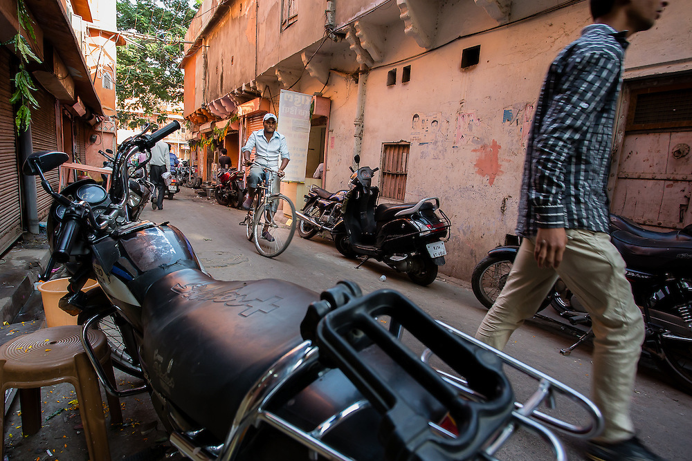 A bike passes on one of the back streets in the city of Jaipur