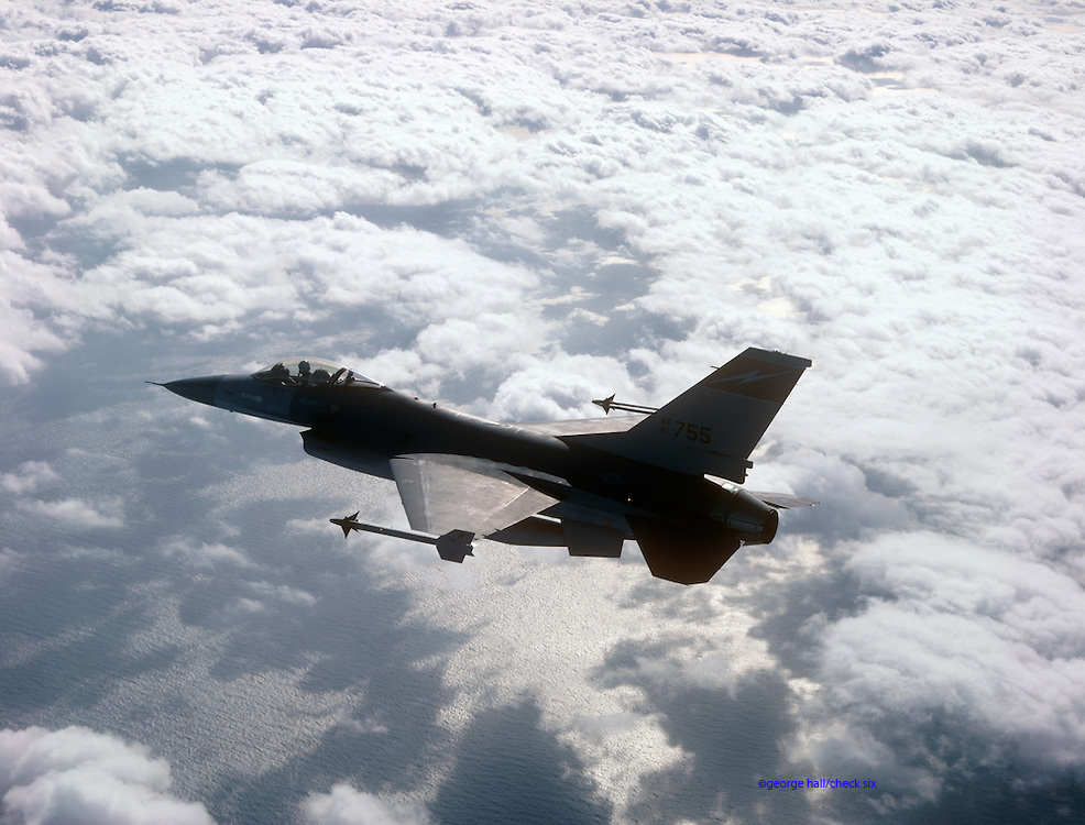 F-16 Falcon Flying above the clouds