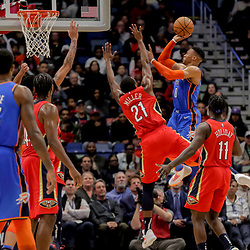 Dec 12, 2018; New Orleans, LA, USA; Oklahoma City Thunder guard Russell Westbrook (0) shoots over New Orleans Pelicans forward Darius Miller (21) during the second half at the Smoothie King Center. Mandatory Credit: Derick E. Hingle-USA TODAY Sports