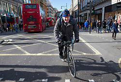 © Licensed to London News Pictures. 23/02/2016. London, UK. Mayor of London BORIS JOHNSON riding his bike along Oxford Street as he leaves a Crossrail construction site near Bond Street in central London after attending a visit by Queen Elizabeth II. Photo credit: Peter Macdiarmid/LNP