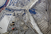 Detail from one of the enormous tailings ponds in Fort McMurray in Alberta, Canada. The ponds are among the largest man made structures in the world, spanning more than 175 square kilometres. They pose an added challenge to the oil sands production: even after ended production, it can take up to 30 years for the silt in the ponds to dry up. The contaminated water is toxic to any living creatures. The Athabasca oil sands deposit is among the largest in the world.  The bitumen, also commonly named tar (hence tar sands), contains lots of hydrocarbons, but is notoriously hard to extract. For every 100 BTU of energy extracted, 70 BTU is lost in the process. In 2011 alone, the oil sands operations in Canada produced 55 million tons of 'greenhouse gas emissions'. That's eight percent of Canada's total emissions.
