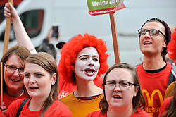 © Licensed to London News Pictures. 04/09/2017. London, UK. A woman dressed as Ronald McDonald joins McDonald's staff and members of the Bakers Food and Allied Workers Union (BFAWU) at a rally outside the Houses of Parliament in solidarity with McDonald's staff in Cambridge and Crayford who have gone on strike demanding an end to zero hours contracts and a minimum wage of GBP10 per hour.   Photo credit : Stephen Chung/LNP
