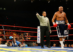 October 6, 2007; New York, NY, USA; Jameel McCline (dark blue) knocks down WBC Heavyweight Champion Samuel Peter during the third round of their 12 round bout at Madison Square Garden in New York.