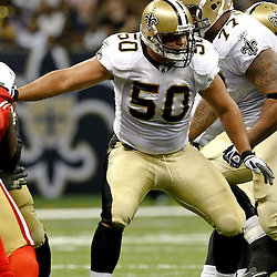 August 12, 2011; New Orleans, LA, USA; New Orleans Saints center Olin Kreutz (50) against the San Francisco 49ers during the first half of a preseason game at the Louisiana Superdome. Mandatory Credit: Derick E. Hingle