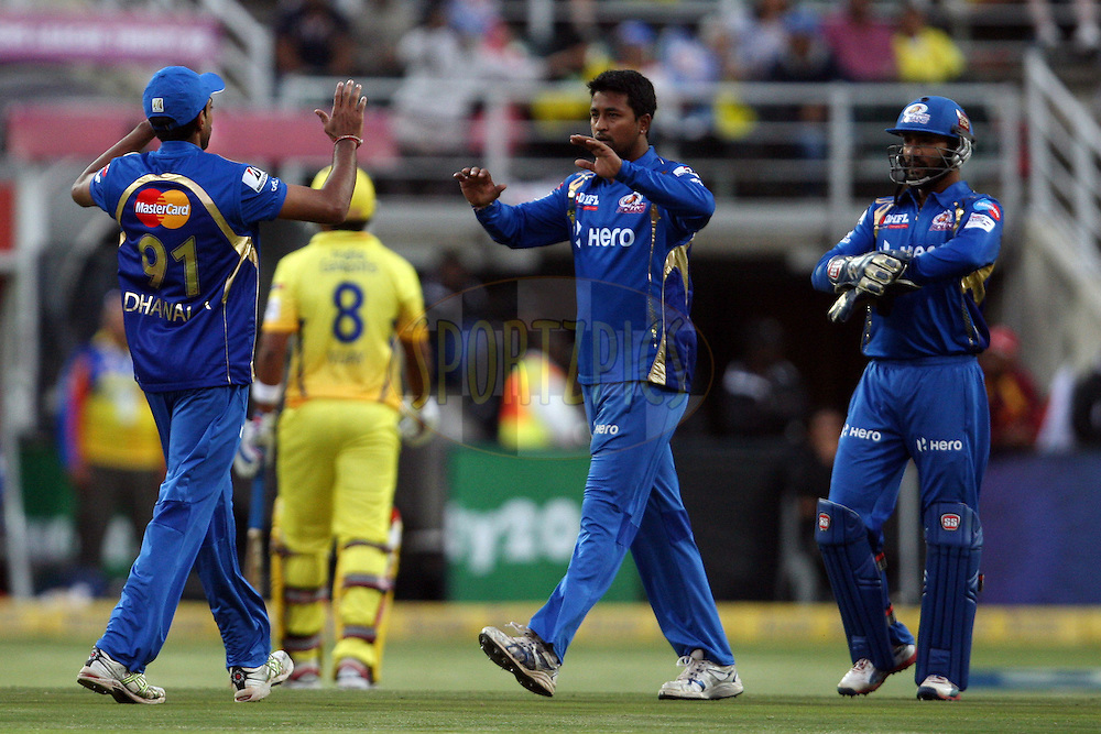 Mumbai Indians players celebrate a wicket during match 13 of the Karbonn Smart CLT20 South Africa between The Chennai SUperkings and The Mumbai Indians held at The Wanderers Stadium in Johannesburg, South Africa on the 20th October 2012. Photo by Jacques Rossouw/SPORTZPICS/CLT20