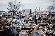 High winds and water from Hurricane Sandy caused a devastating fire that burned down at least 111 houses in Breezy Point, a beach community in the Rockaways.