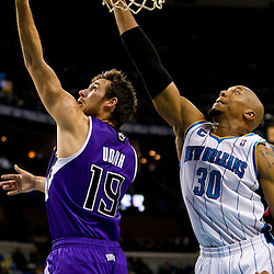 December 15, 2010; Sacramento Kings point guard Beno Udrih (19) shoots over New Orleans Hornets power forward David West (30) during the second half at the New Orleans Arena. The Hornets defeated the Kings 94-91. Mandatory Credit: Derick E. Hingle