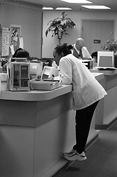 Stock photo of medical personnel at a nurses station