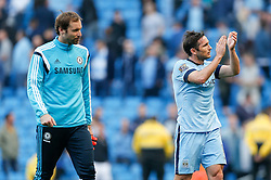 Goalscorer Frank Lampard of Manchester City (who scored against his former side to make it 1-1) leaves the pitch with ex teammate and Chelsea reserve goalkeeper Petr Cech - Photo mandatory by-line: Rogan Thomson/JMP - 07966 386802 - 21/08/2014 - SPORT - FOOTBALL - Manchester, England - Etihad Stadium - Manchester City v Chelsea FC - Barclays Premier League.