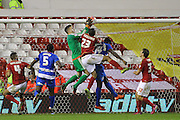 Nottingham Forest goalkeeper Dorus de Vries makes a last-minute save during The FA Cup third round match between Nottingham Forest and Queens Park Rangers at the City Ground, Nottingham, England on 9 January 2016. Photo by Aaron Lupton.