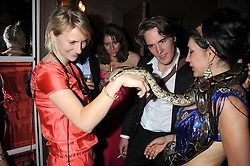 MICKEY SUMNER and snake at a party hosted by the Supper Club in honour of Mary Greenwell held at Beach Blanket Babylon, Ledbury Road, London on 25th June 2008.<br /><br />NON EXCLUSIVE - WORLD RIGHTS
