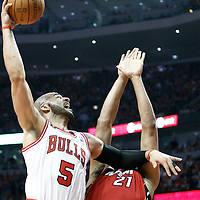 18 May 2011: Chicago Bulls power forward Carlos Boozer (5) dunks the ball over Miami Heat center Jamaal Magloire (21) during the Miami Heat 85-75 victory over the Chicago Bulls, during game 2 of the Eastern Conference finals at the United Center, Chicago, Illinois, USA.